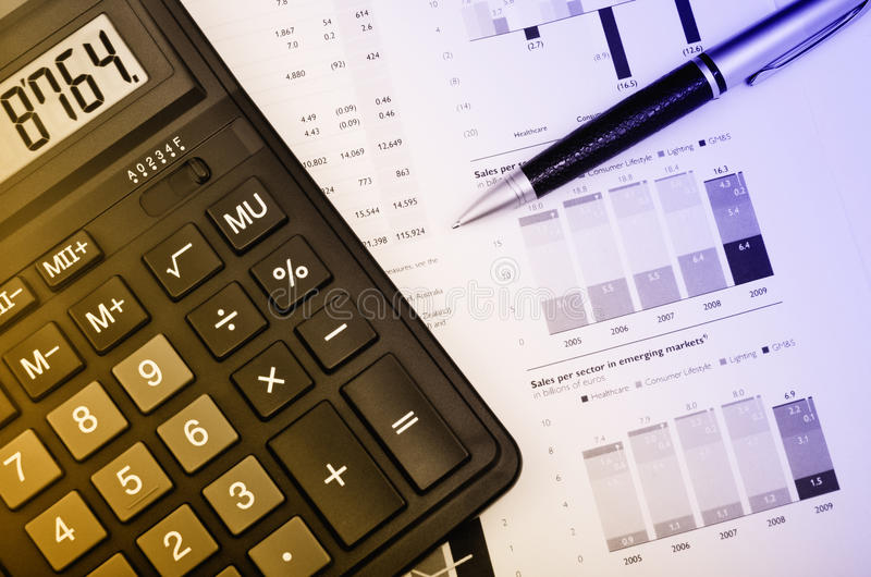 Pen And Calculator Over Annual Report Royalty Free Stock Photo