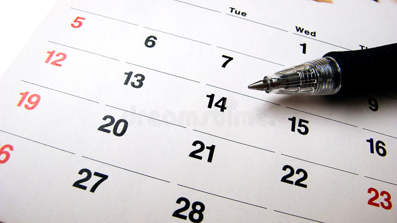 Pen and calendar stock images