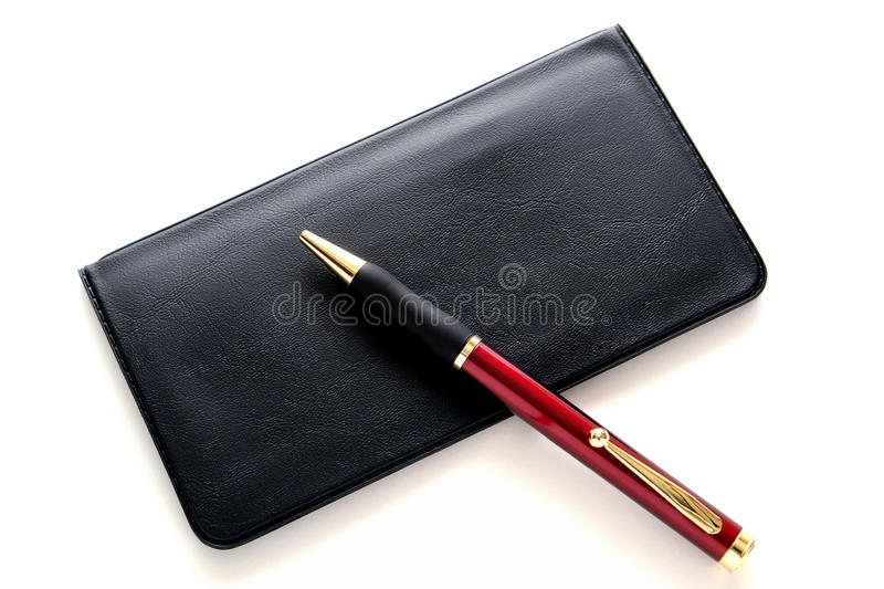 Pen on Checkbook Bank Checks Cover for Budgeting royalty free stock photos