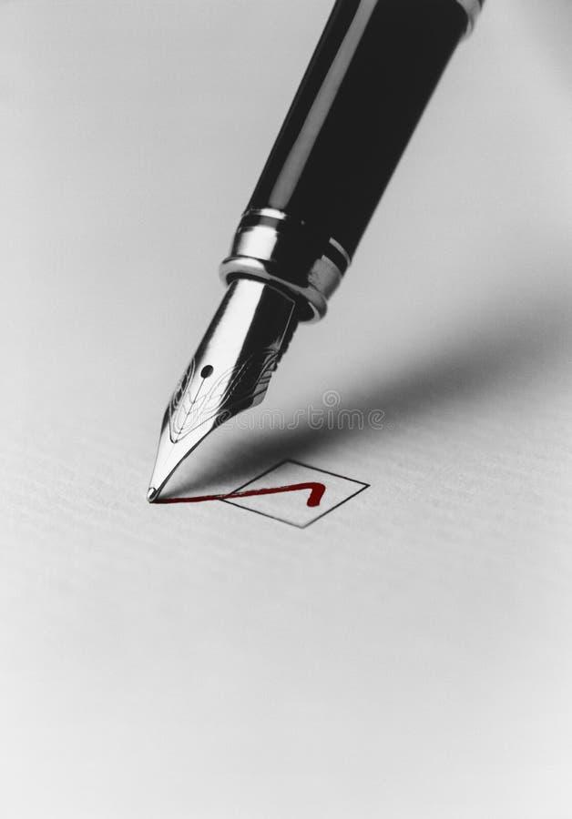 Pen Checking Box imagem de stock