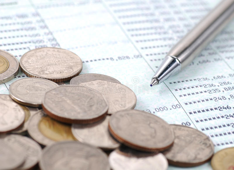 Pen and coins on bank account. Background royalty free stock photos