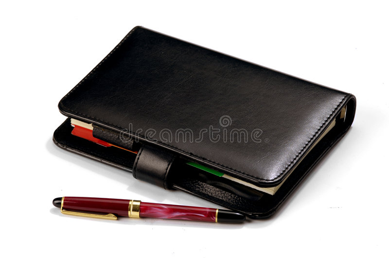 Pen and diary. Pen on a closed personal diary royalty free stock images