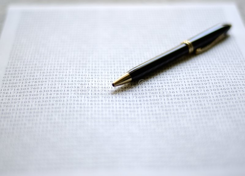 Pen on document royalty free stock photo
