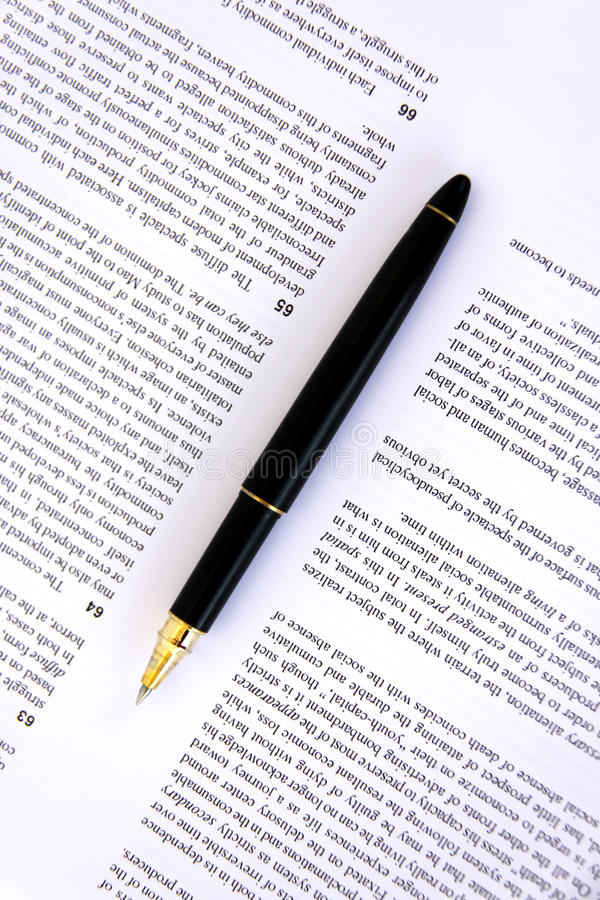 Download Pen on a document closeup stock photo. Image of text - 16184574