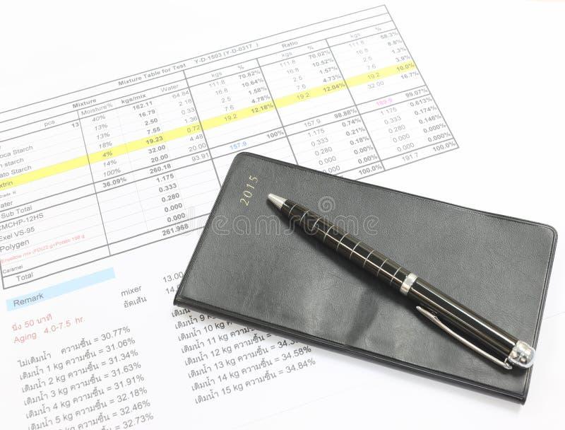 Pen en zwart notitieboekje royalty-vrije stock foto