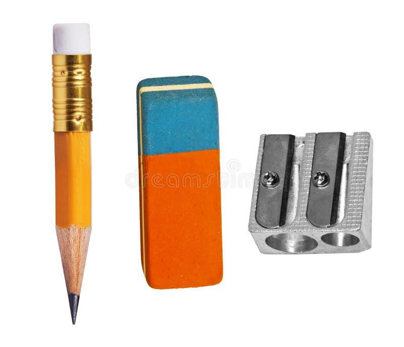 Pen, eraser and sharpener. On white royalty free stock photo