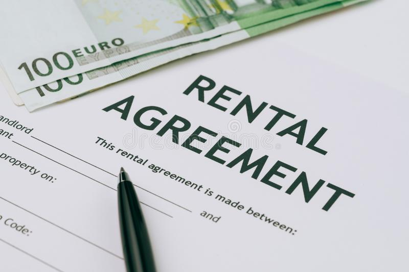 Pen and Euro banknotes money on rental agreement form document,. Ready to sign contract, property or real estate concept stock images
