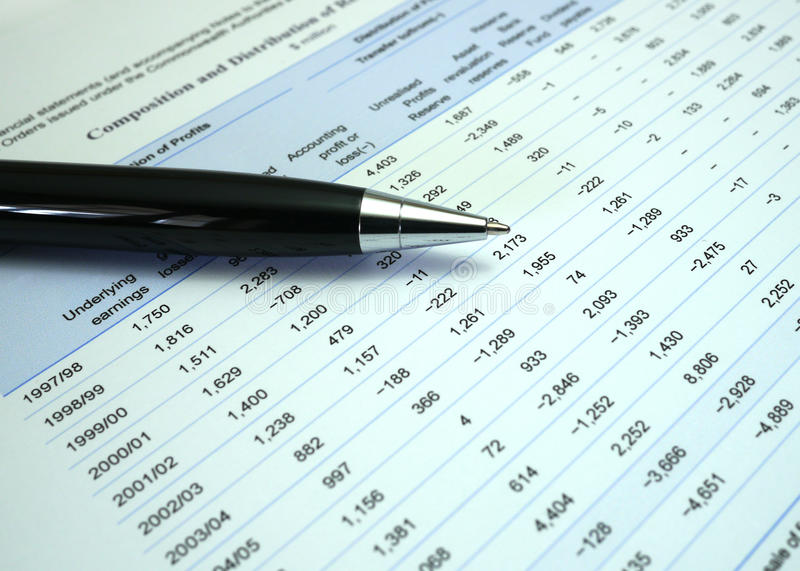 Pen on financial numbers stock images