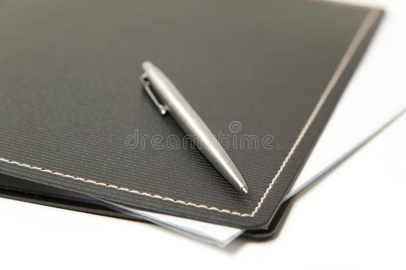 Pen and folder close up