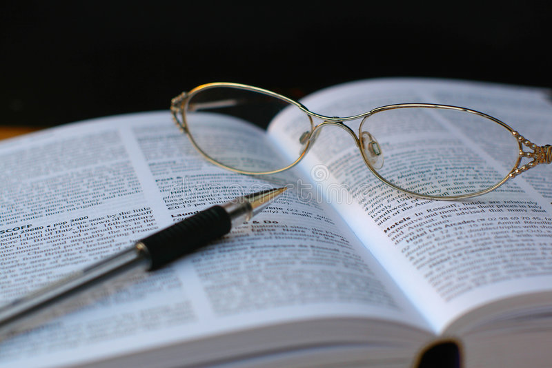 Download Pen And Glasses On Book Page Stock Photo - Image of guidebook, learn: 1306194