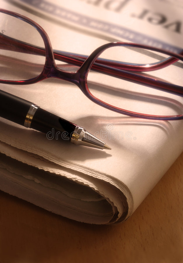 Download Pen And Glasses On Newspaper Stock Image - Image: 1207213