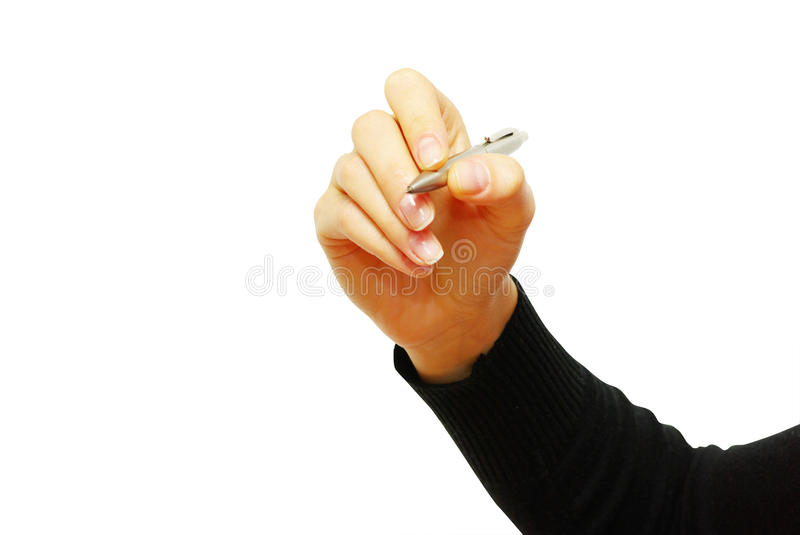 Pen in hand. Pen in woman hand isolated on white background stock photo