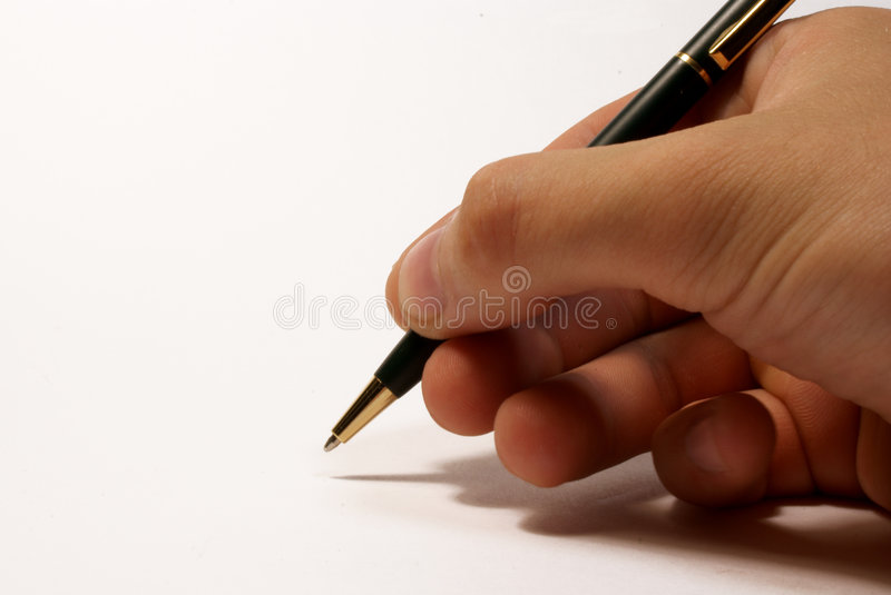 The pen in the hand stock photography