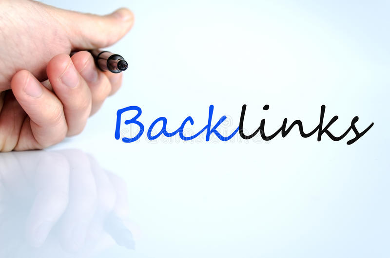 Pen in the hand backlinks concept. Pen in the hand over white background backlinks concept stock photos