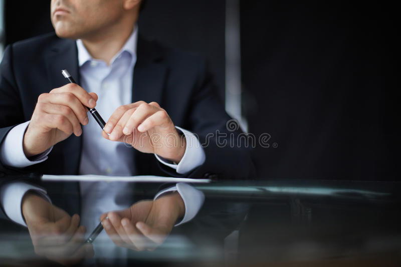 Pen in hands royalty free stock photography