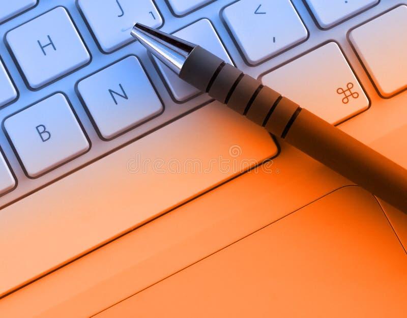Pen on keyboard royalty free stock image