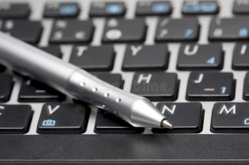 Pen on Keyboard royalty free stock photo