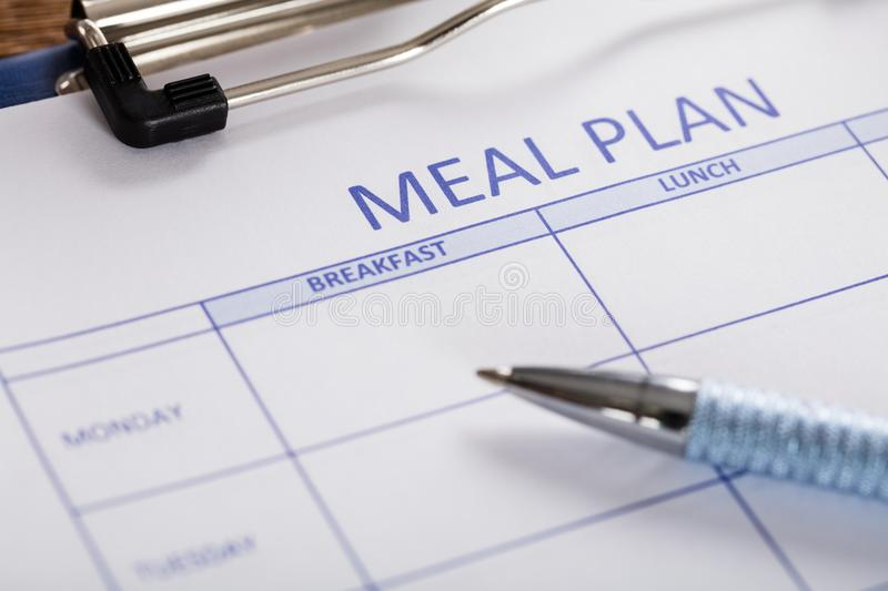 Pen With Meal Plan Form. Close-up Of Pen With Meal Plan Form stock photo