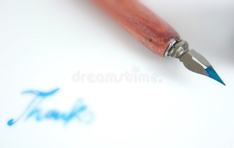 Pen with nib and ink. Closeup of a pen with nib and ink, and soft word thanks on white paper royalty free stock photos