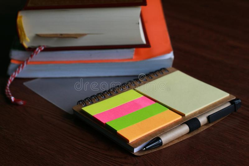 A pen note colorful with paper sheet and books props. Work writing note with pen and books paper sheet props royalty free stock images