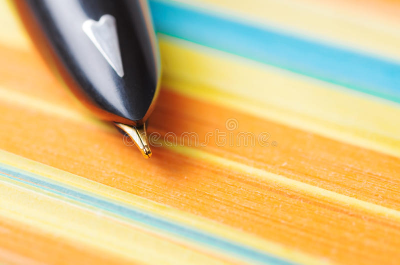 Pen with note paper macro royalty free stock photo
