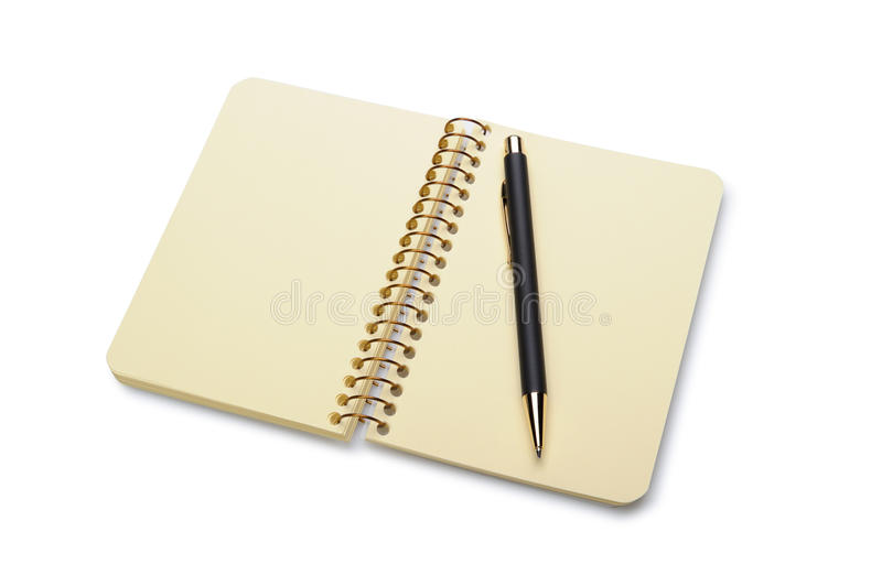 Pen and a notebook stock image