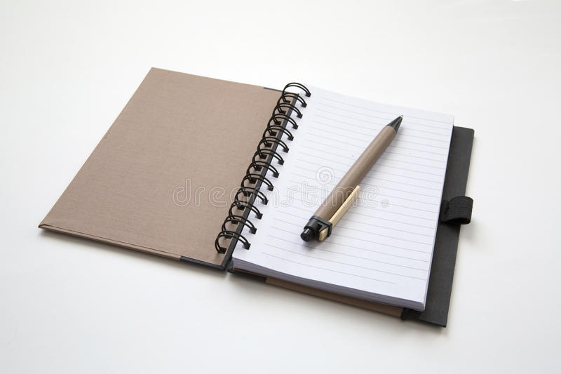 Pen and notebook royalty free stock image