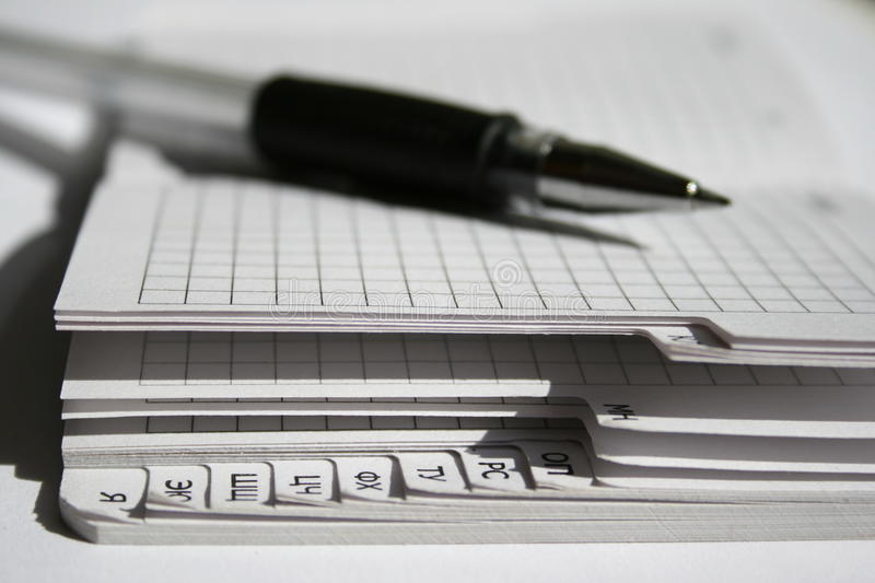 A pen and a notebook stock image