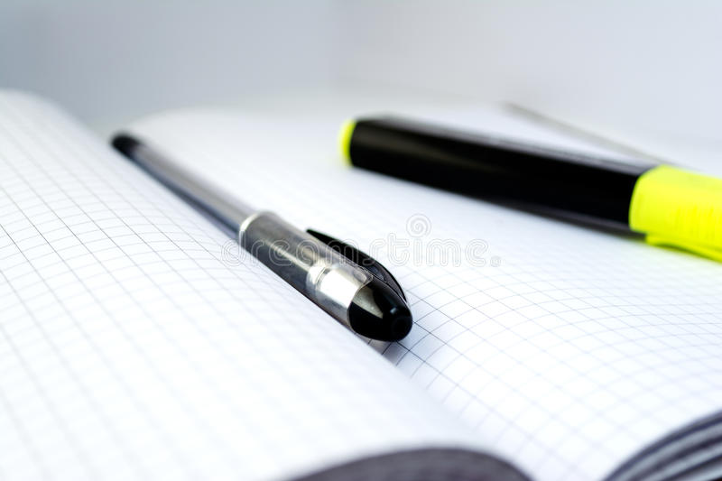 Pen on a notebook stock images