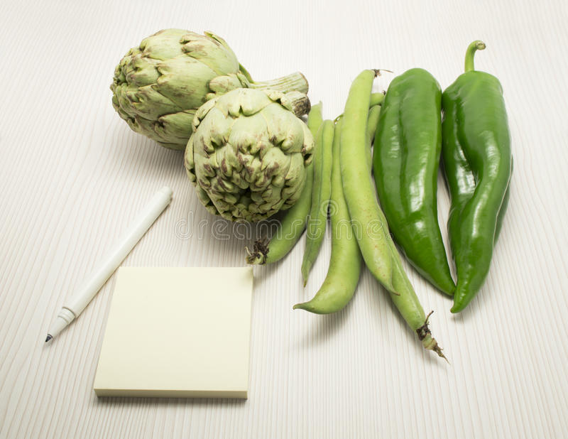 Pen Notebook And Fresh Vegetables Royalty Free Stock Photography