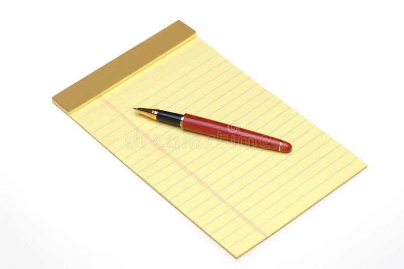Pen op Geel Stootkussen stock foto