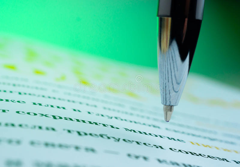 Pen on a opened book. Macro image. library, education,. Pen on a opened book. Macro image. library, education literature a surge of knowledge royalty free stock photos