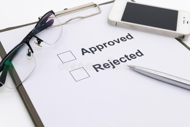 Pen over document, select Approved or Rejected. stock image