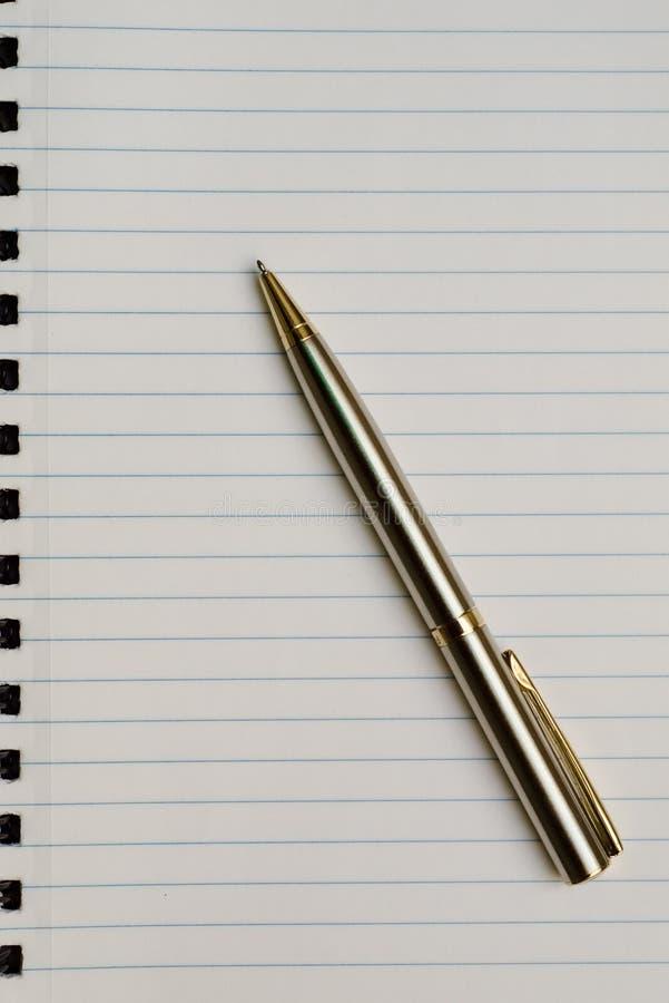 Pen over paper stock photo