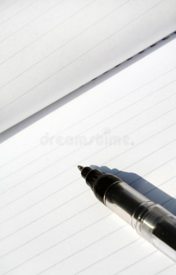 Pen and pad. stock photography