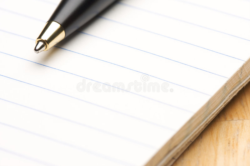 Pen and Pad of Paper royalty free stock photo