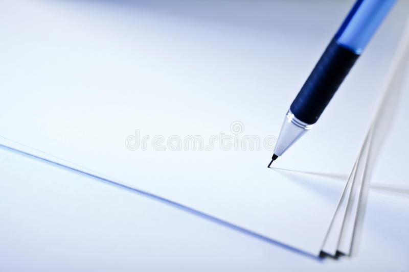 Pen on paper. Pen on sheets of white paper royalty free stock photo