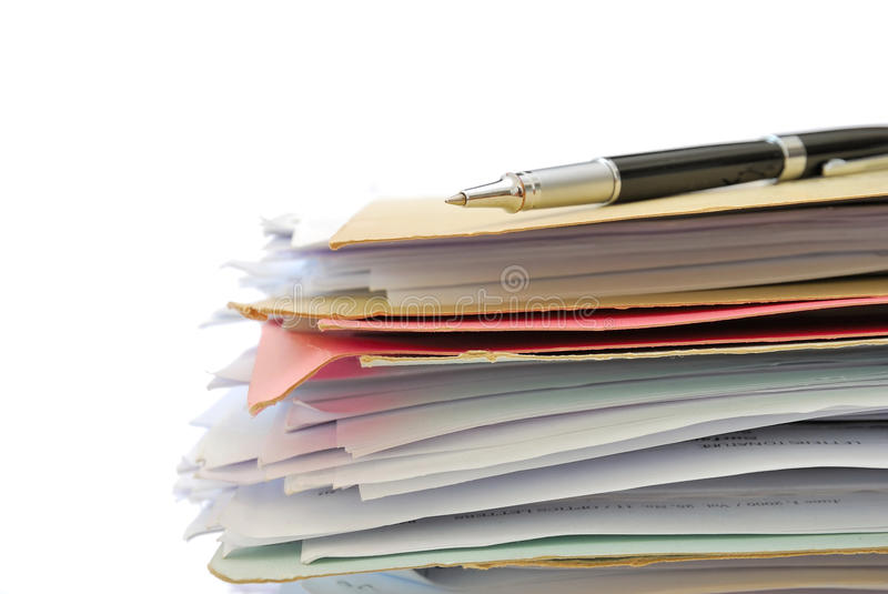 Pen on pile of files on white background royalty free stock image