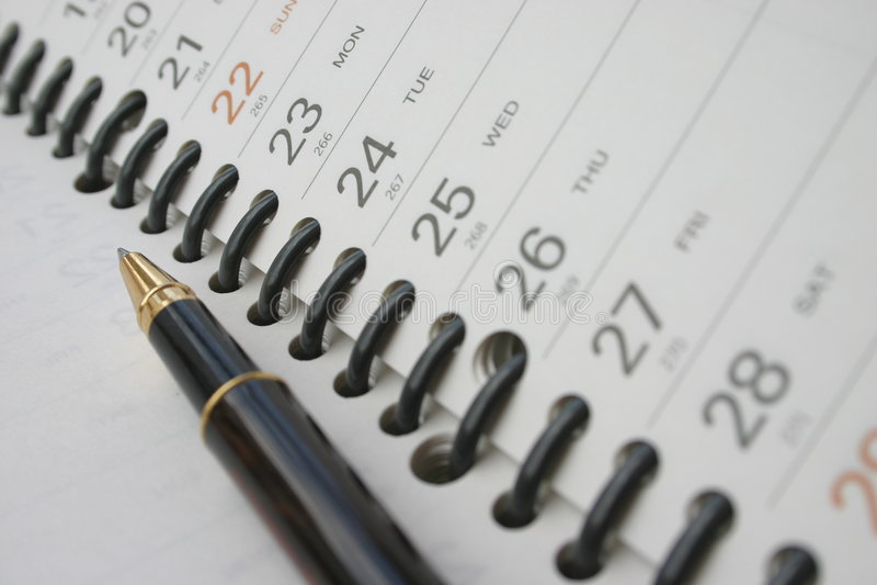 Pen on planning diary stock photos