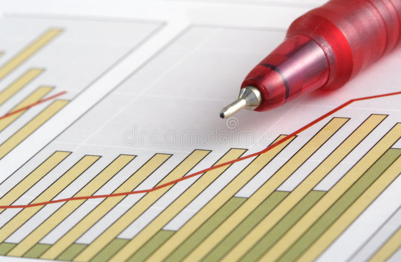 Pen on Positive Earning Chart royalty free stock photography