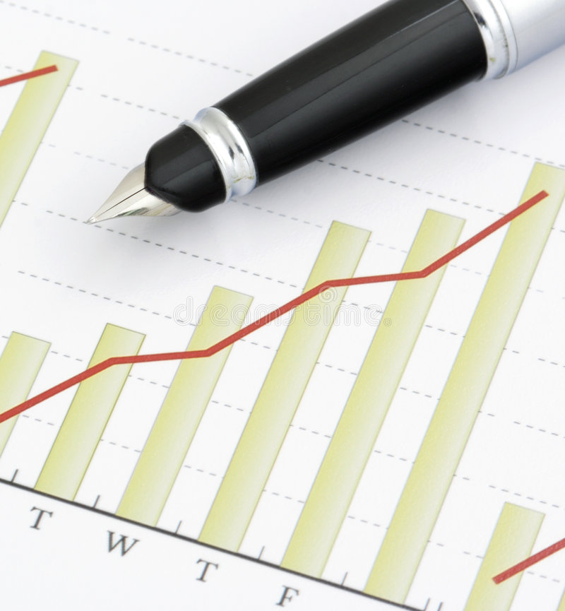 Pen on Positive Earning Graph royalty free stock image