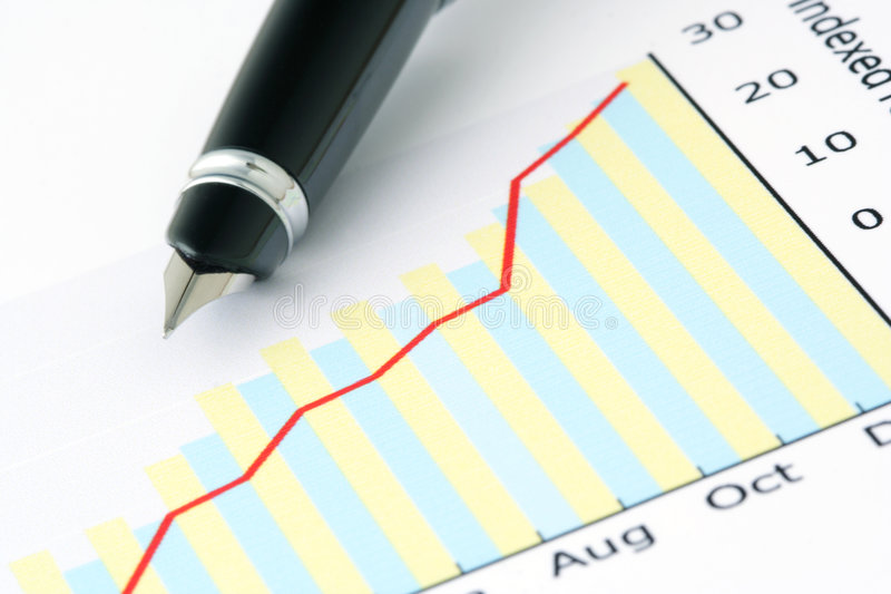 Pen on Positive Earning Graph royalty free stock photos