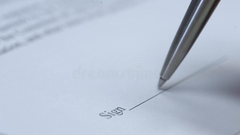 Pen ready to sign documents macro view, business contract, management agreement stock images