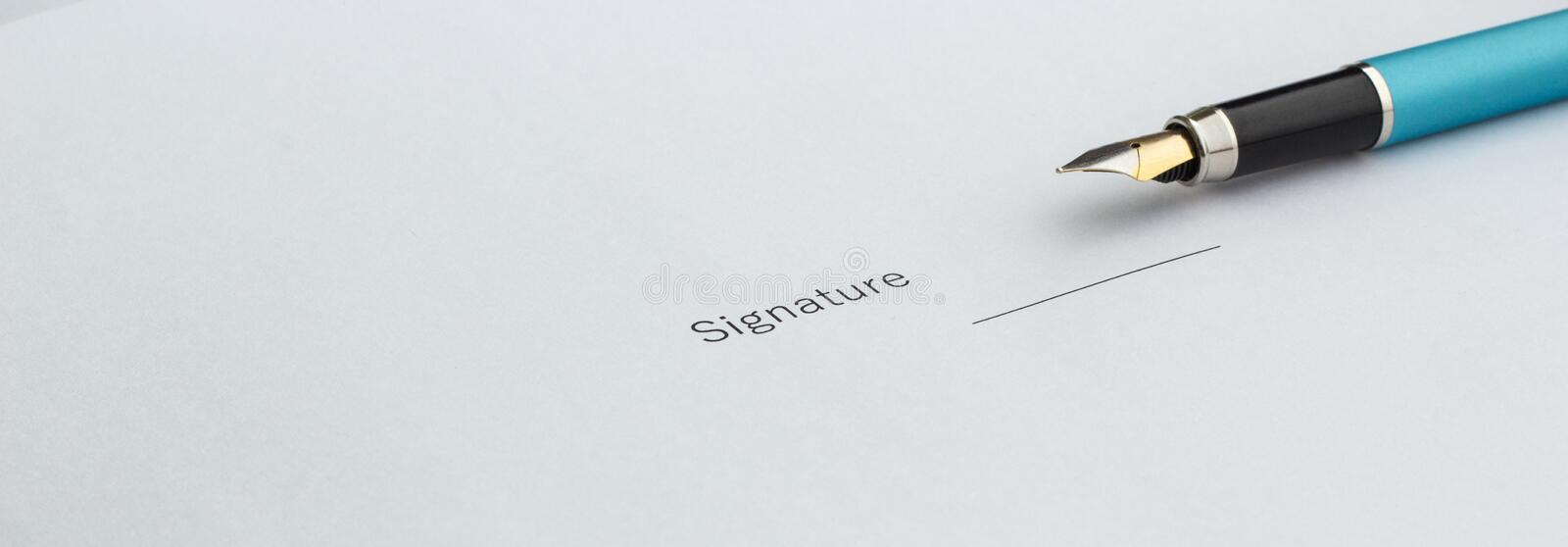 Pen for signing an important document, close-up royalty free stock images
