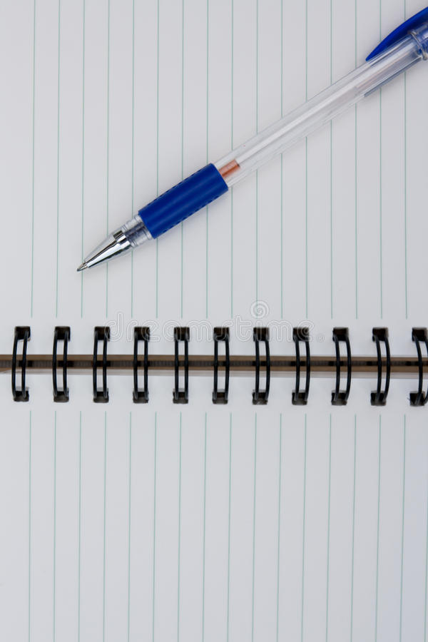 A pen on a spiral notebook. stock photography