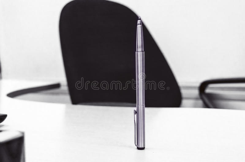 Pen standing facing office chair in black and white style stock images