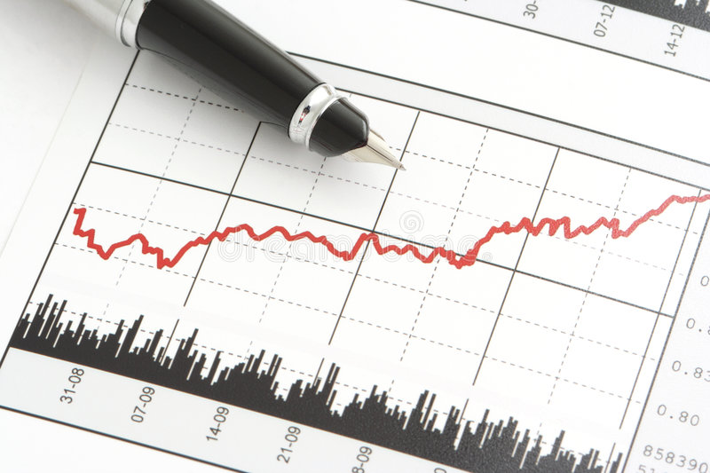 Pen on Stock Price Chart. Close-up shot of a pen on stock price chart royalty free stock photography