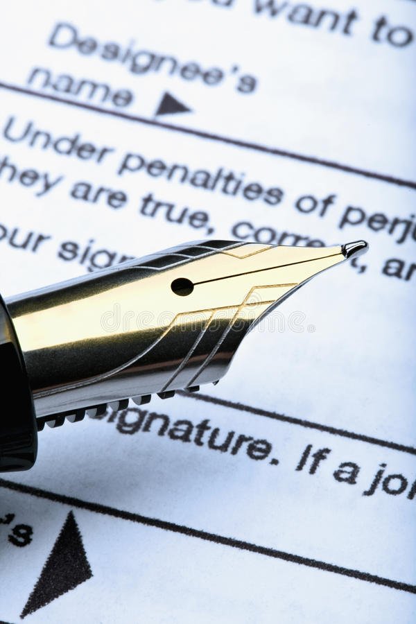 Pen and tax form. 1040 u.s. individual income tax return form and fountain pen stock photography