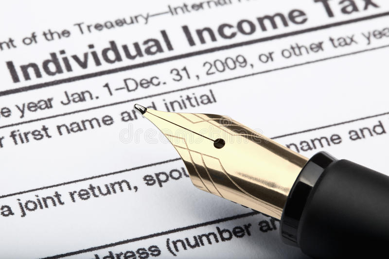 Pen and tax form. 1040 u.s. individual income tax return form and fountain pen stock photo