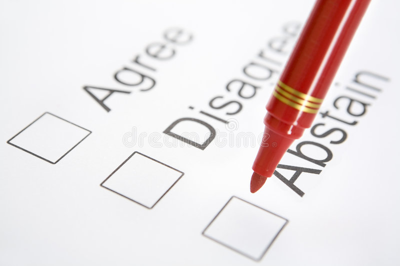 Pen on top 'Abstain' checkbox. Red pen is about to choose 'Abstain', placed on top of the checkbox. Focus on the pen. There is soft vignette around the corner stock image